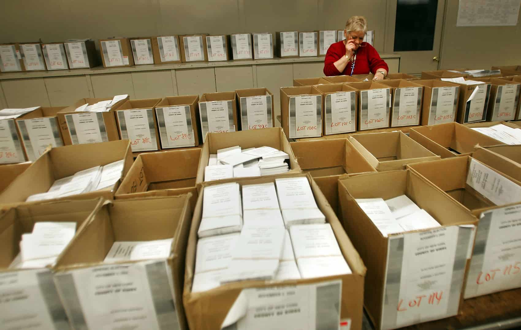 Expat voting: A poll worker looks over thousands of absentee ballots