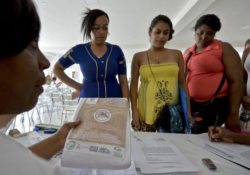 Health workers hand out mosquito nets to pregnant women in Calí, Colombia, to fight the Zika virus.