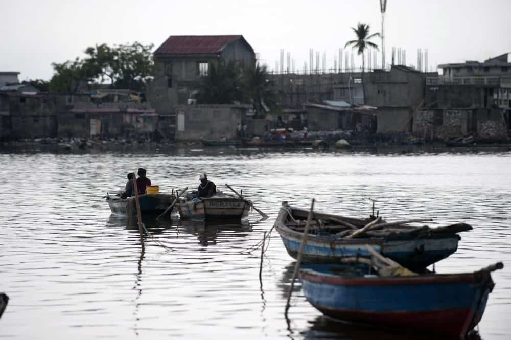 Fisherman sit in their boats at a wharf close to the Haiti port of Cap-Haïtien.