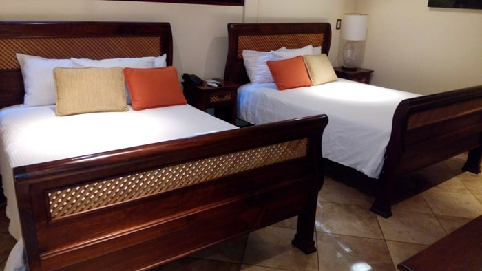 Beds at Bosque del Mar, with the lattice woodwork theme used throughout the hotel.