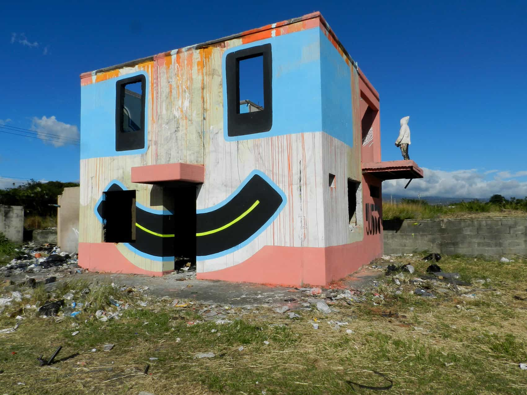 """Gussa's """"Time Machine"""" depicts a 3D happy face located near the Juan Santamaría Airport."""