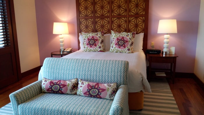A recent remodeling introduced lots of bright colors in bedrooms that match the flowers outside the windows.