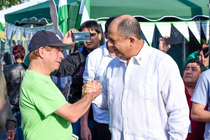 President Luis Guillermo Solís greets a National Liberation Party follower upon his arrival at the Mexico school in Barrio Aranjuez, San José. Municipal elections.