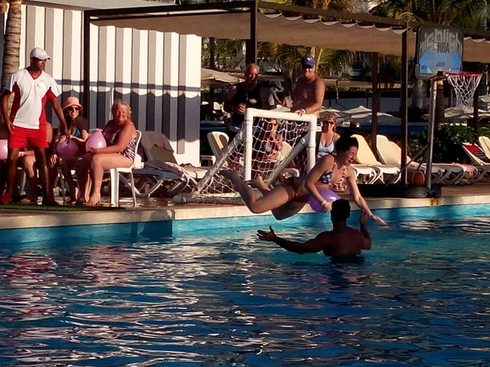 A lively contest where revelers try to pop a balloon with a belly-flop in the pool.