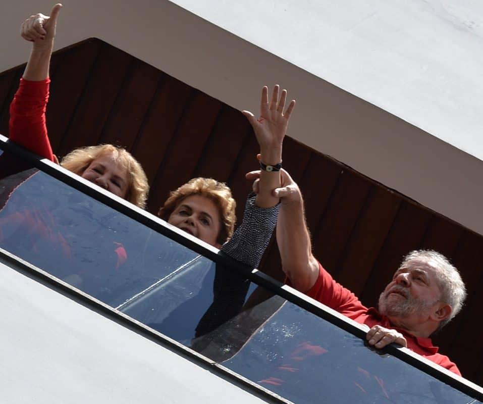 Former Brazilian President Luiz Inacio Lula da Silva, right, current President Dilma Rousseff, center, and Lula's wife Marisa Leticia