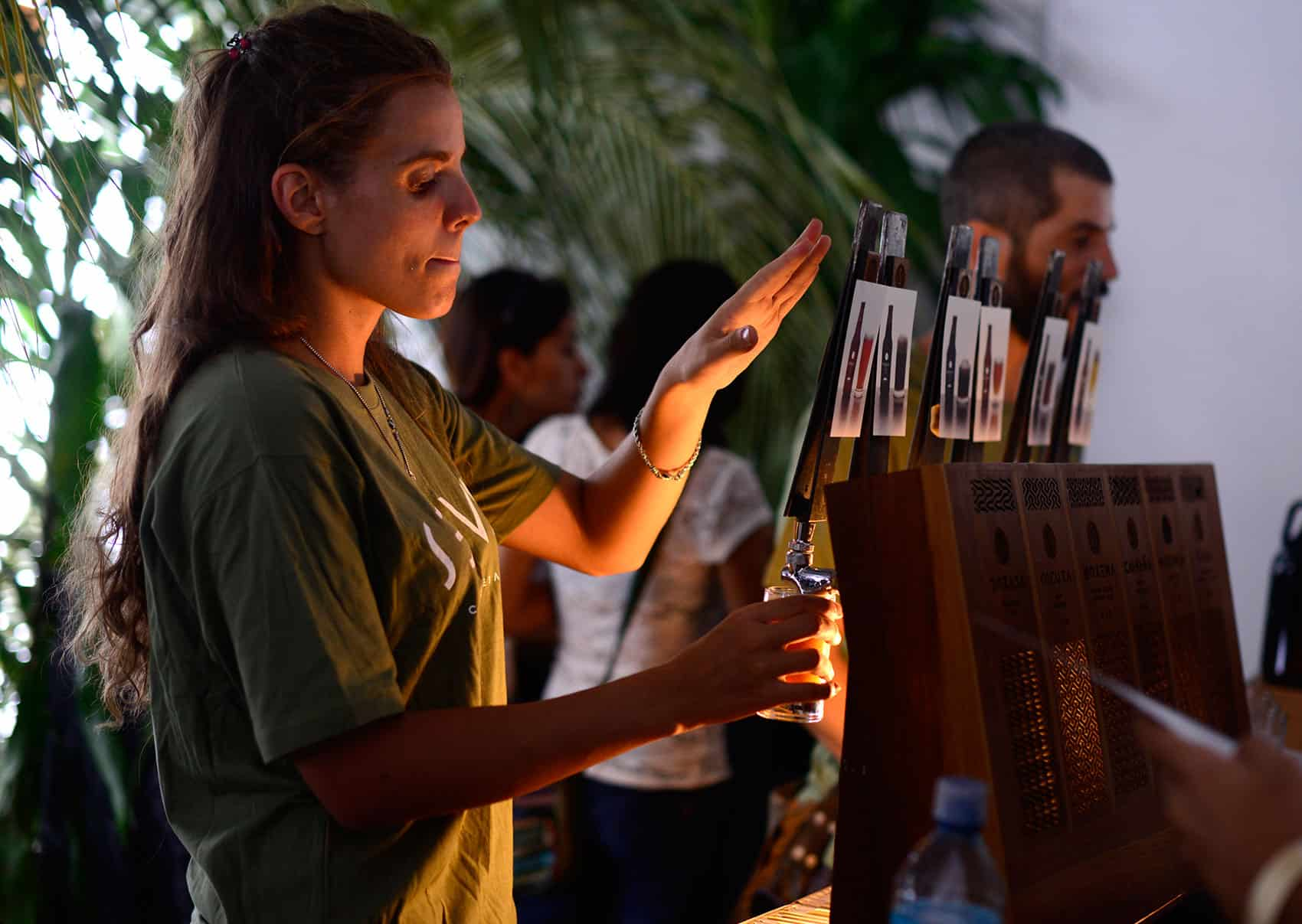 Costa Rica Craft Beer Festival: A bartender pours beer at Selva brewing company