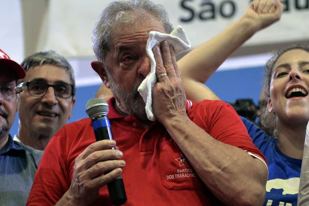Brazil's former President Luiz Inacio Lula da Silva wipes away tears.