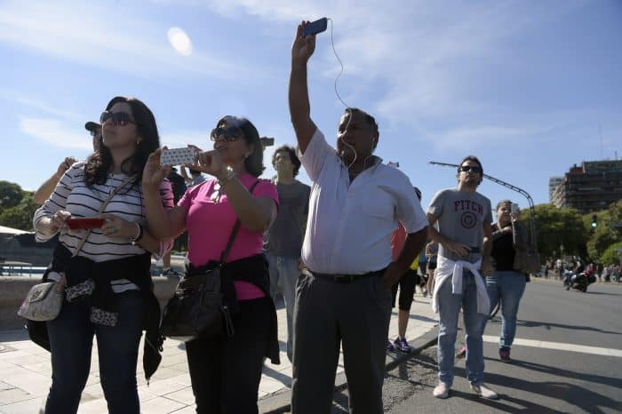 Bystanders watch Obama in Argentina