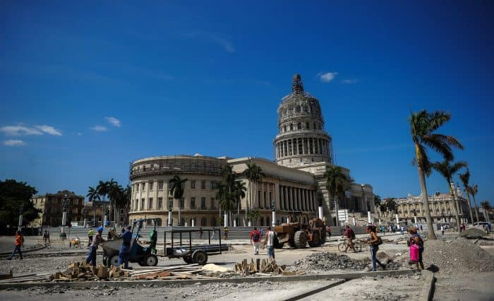 Workers repair a street near the Capitol in Havana, Cuba, on March 16, 2016, during preparations ahead of U.S. President Barack Obama's visit.