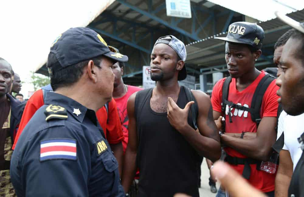 Migrants with police at Costa Rican border
