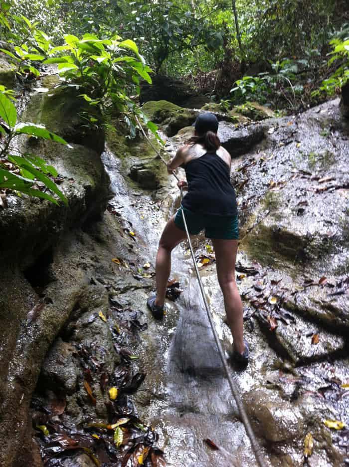 Mia climbs a waterfall.