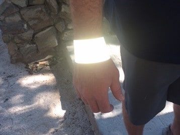 The same wristband lights up when photographed with a flash.