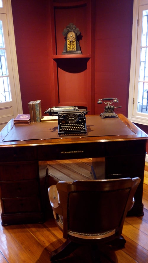Desk with Olivetti typewriter and early telephone.