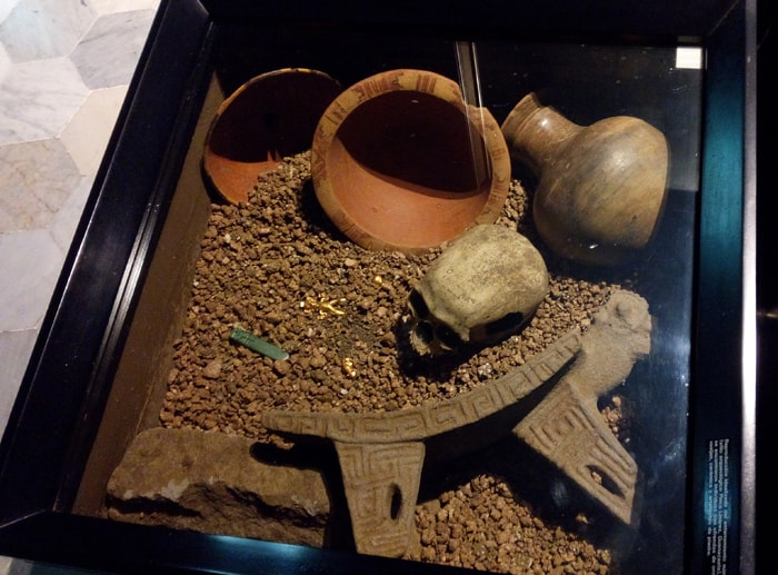 Recreation of indigenous grave, with gold and jade amulets.