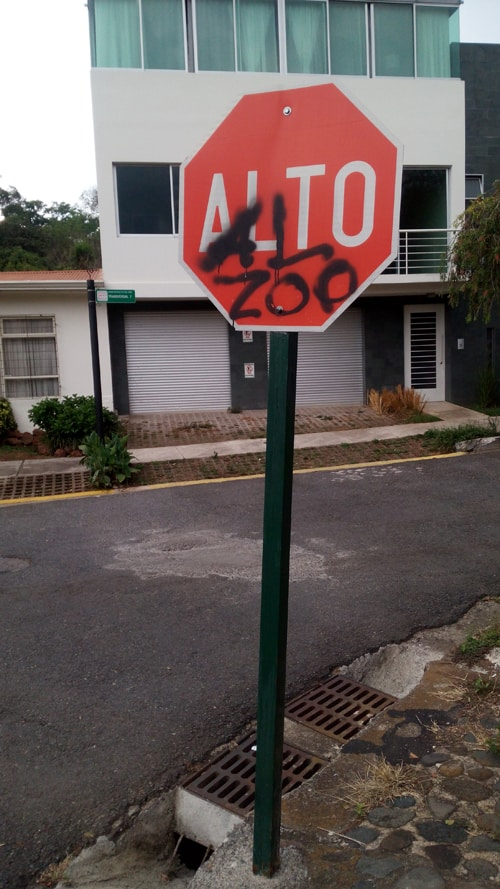 "Graffito on a stop sign near the zoo says ""Stop the Zoo."""