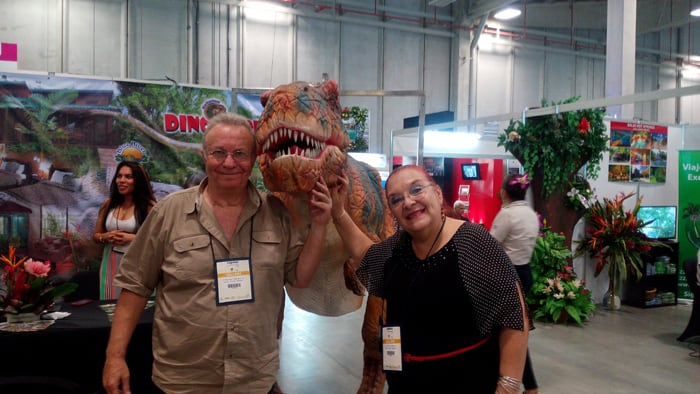 Daniel Apelboim and Violeta Hansen of Blue River Lodge and Dino Park, with dino friend.
