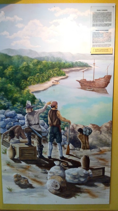 Painting depicting pirates at the Roatán Museum.