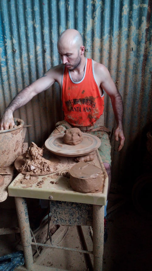 A raw piece of clay is ready to turn into the base for a pot.