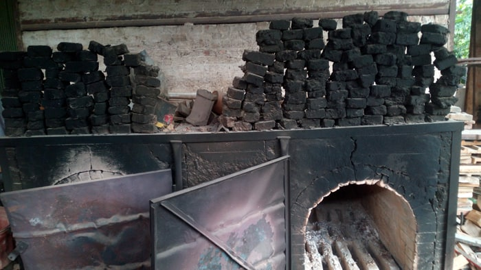 Ovens where wood is burned to heat the main kiln.