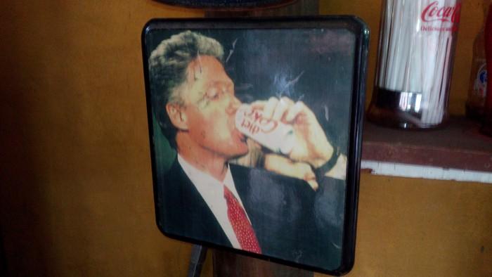 President Bill Clinton guzzles a Diet Coke.