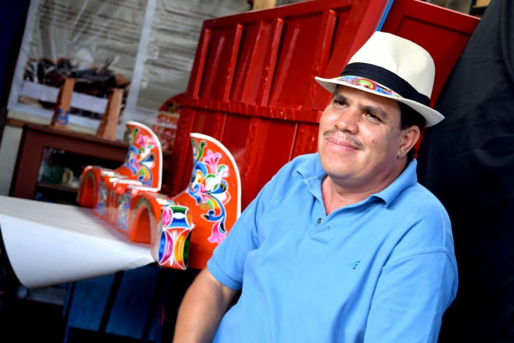 Luis Madrigal depicts the Costa Rican identity through the use of bright colors and shapes on the oxcarts.