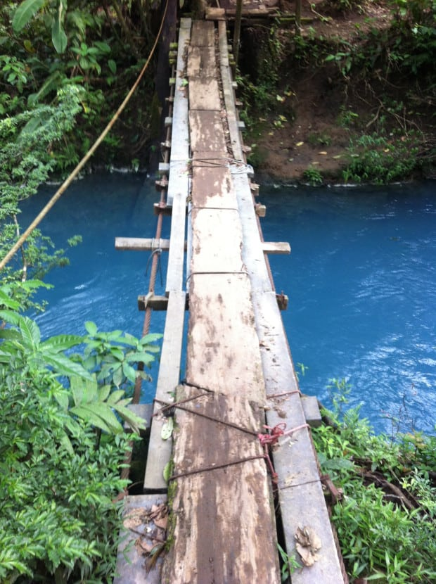 A rickety bridge over the stunning Río Celeste.