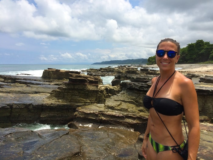 Cristina soaks up some sun at the tide pools in Malpaís.