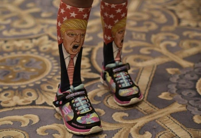 A Donald Trump supporter wears socks featuring the candidate, Washington, DC, September 2016.