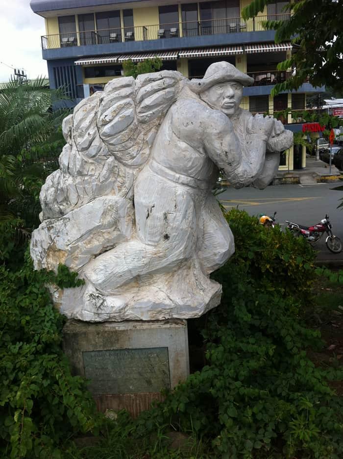 A sculpture along the Quepos malecón recalls the era when this was a banana town.