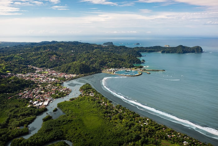 Quepos from the air: Mangroves, town, marina, Punta Quepos and in the distance Manuel Antonio.