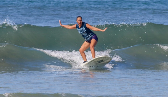 Guiselle Vidal, who doesn't know how to swim, catches her first wave at Playa Guiones.