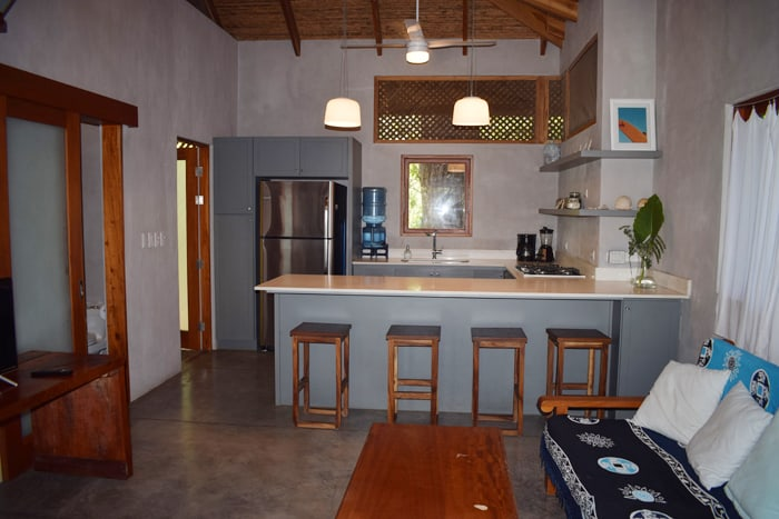 Living room and kitchen at a home for sale represented by Surfing Nosara.