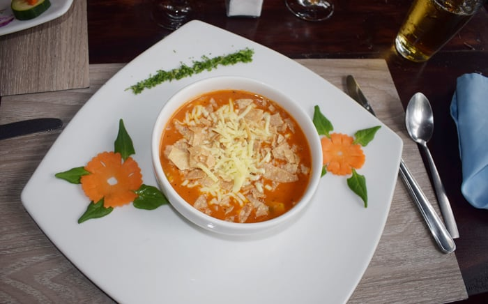 Cream of tomato soup at Rancho Perla, enlivened upon request by tortillas and mozzarella cheese.