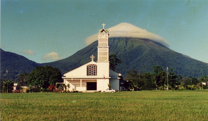 Arenal seems to be wearing a white hat in 1990, when La Fortuna's central park was still a soccer field.