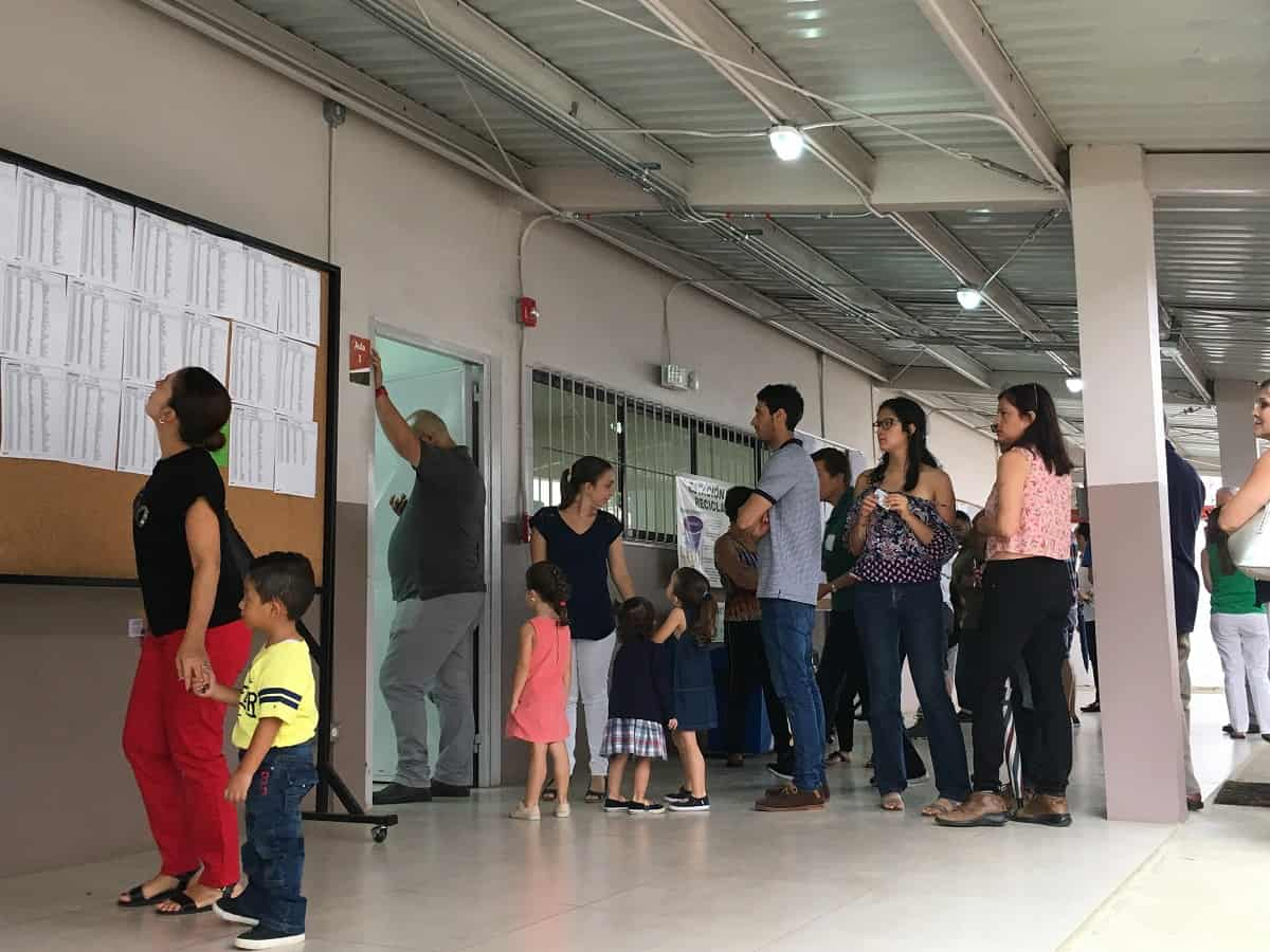Presidential primary voters wait in Curridabat.
