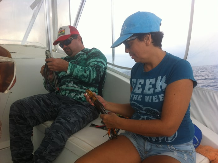 Oscar and Guiselle check the footlong lures, which didn't work today.