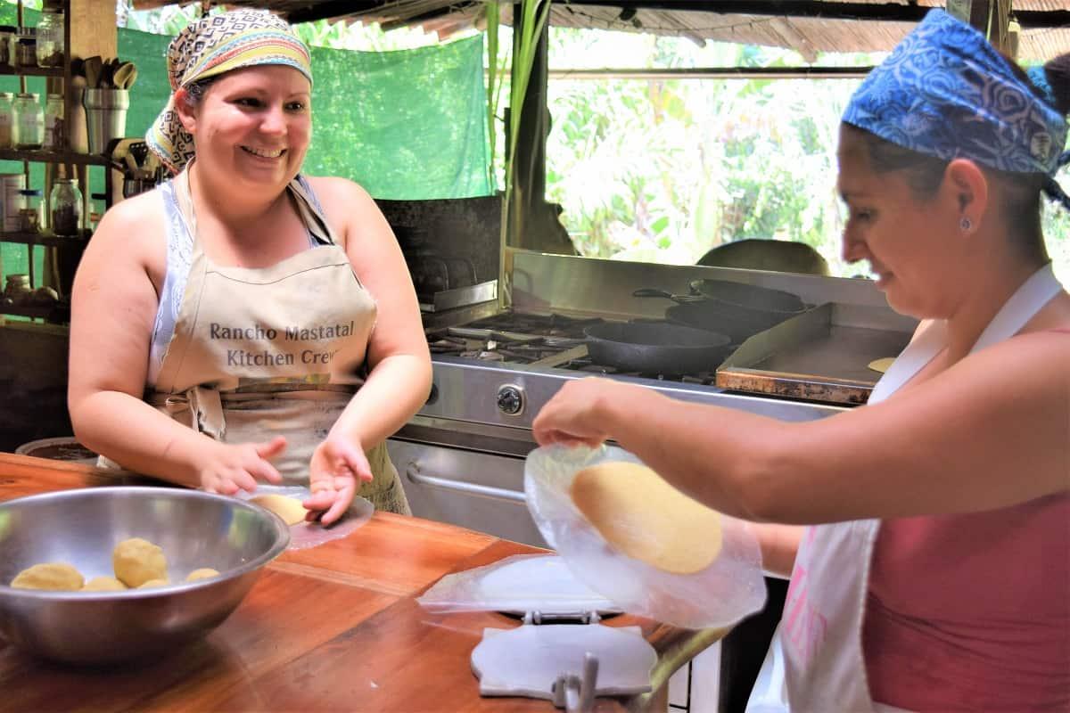 Two women making tortillas in Costa Rica.