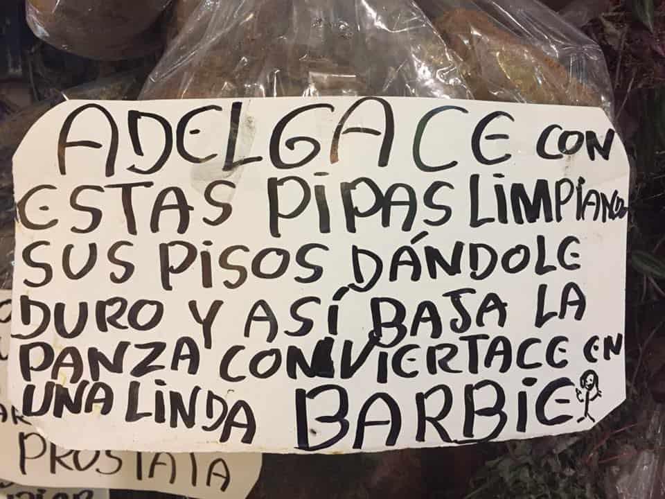 Sign touting the benefits of pipa-sweepiing in San José', Costa Rica's Mercado Central.