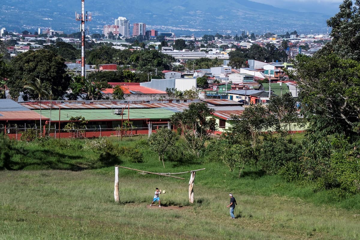 A boy and his grandfather play soccer in San José, Costa Rica.