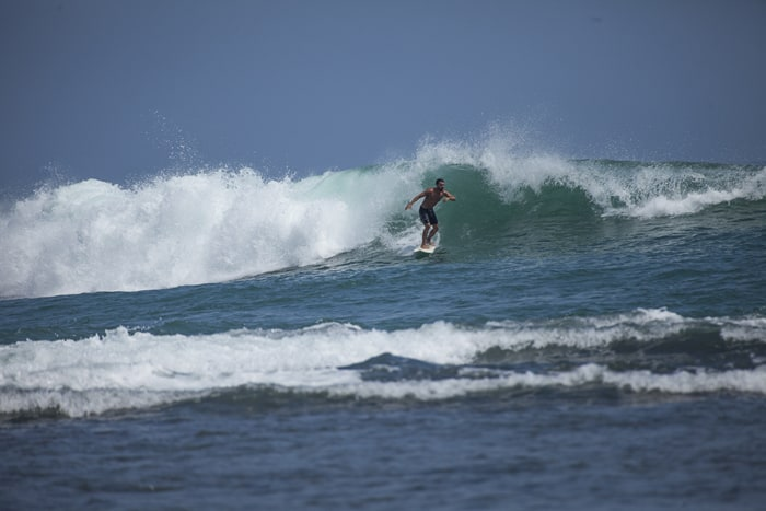 A sufer catches a wave in Puerto Viejo, Costa Rica.