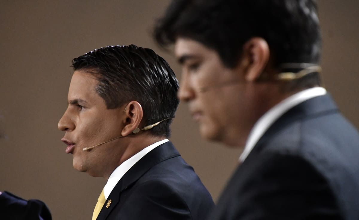 Costa Rican presidential candidates Fabricio Alvarado (L) of National Restoration (RN) and Carlos Alvarado (R) of the governing Citizen Action Party (PAC) participate in a Grupo Extra debate in San José on March 19, 2018.