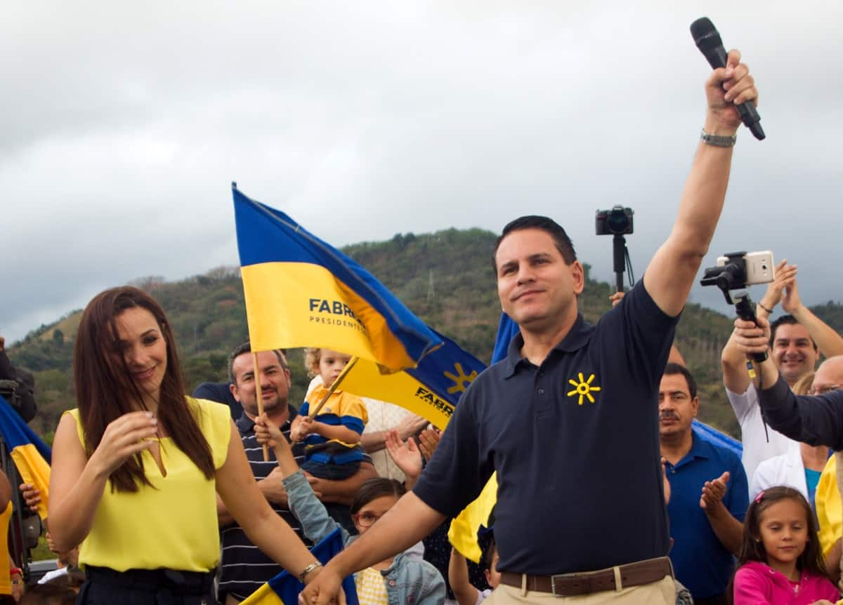 National Restoration Party (PRN) presidential candidate Fabricio Alvarado (R) and his wife Laura Moscoa (L) attend a campaign rally in San Josë, Costa Rica on March 24, 2018.