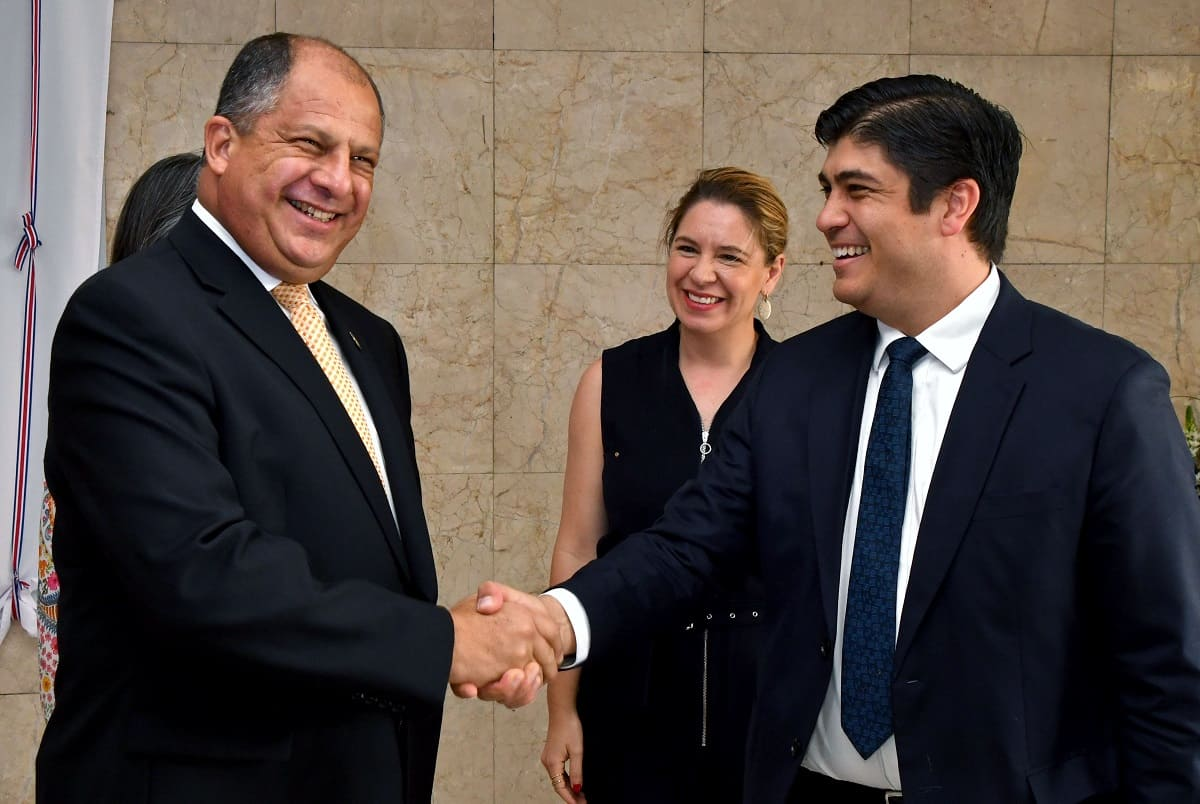 Costa Rican President Luis Guillermo Solís, left, greets President-elect Carlos Alvarado and his wife, Claudia Dobles, as they visit Casa Presidencial on April 18, 2018.