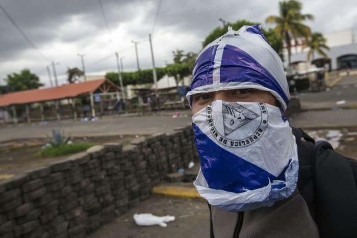 Nicaragua death toll nears 100 as Ortega vows to remain