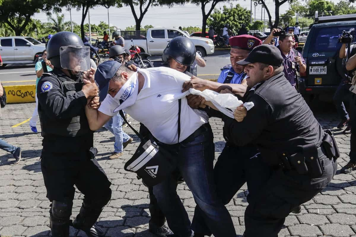 A Nicaraguan man is arrested by riot police during a protest against the government of President Daniel Ortega in Managua, on Oct. 14, 2018.
